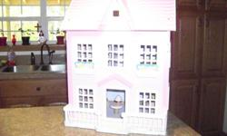 this would make a great Christmas for you little girl or grandaughter. it is just like new and is wood with some kind of vinly covering .The furniture is wood . this is in great shape and clean........ Christmas is just around the corner dont put off