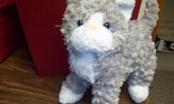 GREAT GIFT IDEA! This cute little stuffed grey and white kitten would make an excellent gift for a child or anyone who likes kittens. This kitten does not need to be fed but cared for with love.