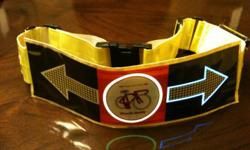 Safety Bike Belt www.signobike.net REFLECTIVE LIGHT POWERED SAFETY BELT - DESIGNED FOR BICYCLE RIDERS WORLDWIDE - for kids, adults, men & women. Illuminated reflective safety belt flashes EL POWERED LIGHTS of LEFT & RIGHT arrows as rider turn, notifying