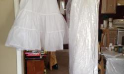 """A MUST HAVE- beautiful white wedding dress in EXCELLENT CONDITION. Also under slip size 10 - $25.00 (NEW) Lavender accessories such as tie backs for chairs. 10- 16"""" vases and much more."""