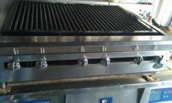 """USED - DCS 36"""" Countertop Radiant Gas Charbroiler Grill Cleaned and in Good Condition Asking: $450 Stainless steel sides and front valve cover. Grill surface that measures 34""""W x 21""""D All burners are controlled by individual valves Heavy duty cast iron"""