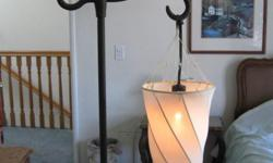 We have this pretty nice decorative comfort giving lamp for sale. It is used, but in very good condition. The stand is metal, but I don't know if this is wrought iron. It just looks pretty though. we can only accept cash.