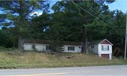 2.72 acres of land with old building located on rt 7 in Dexter being sold as land only. Has well and power but needs septic.  Nice lot to put a mobile home or doublewide on.