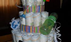 Diaper cakes starting at $20! Made to order... You choose the shape, style, theme & color! Offering traditional tiered cakes, baby booties, bottles and more! Be creative and create a unique centerpiece for your baby shower or nursery!
