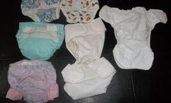 Diaper raps w/velcro 28 total. Used with a few faint stains but in good shape. To be used with cloth diapers. I have Gerber, Green Earth, Prorap and Diaperaps brands. None smoking home and washed with dreft. Call -- 6-13#. Qty. 5 9-16#. Qty. 8 13-26# Qty.