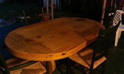 Beautiful dining room table with 4 chairs. See photo (sorry its a little dark) it is very nice. you can come see it - I am near Southern and Olive. Thanks