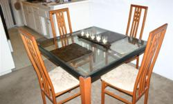 Like new glass top wood chairs and table legs - 4 chair dining room set