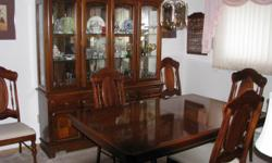 "Table is on a double pedestal and measures 5'6"" in length and 3'8"" wide. Includes five (5) upholstered chairs and one (1) c/w arms. Hutch includes glassed doored cabinet c/w mirror back & lights and mesures 5'9"" in length. All items located in"