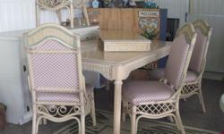 Light color wood .. Rectangle table, with leaf, and six chairs. Wicker trim.