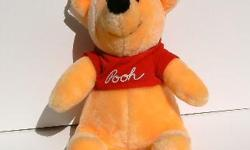 """Winnie the Pooh is 10"""" high and has his tags from Disneyland. Looks new. Would delight any child."""