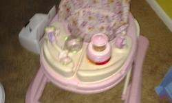 Lights up pink Disney walker with a feeding tray