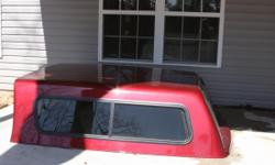 Deluxe Fiberglas Cap- LIKE NEW condition Fits Ram 2006 to2016 Extended Cab Pickup -- Sliding Glass Windows -- Sliding window between cap and cab interior -- All glass on back door -- Upgraded locks on all four sides -- Stoplight