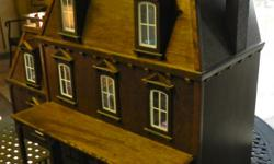 """Wooden Victorian dollhouse, eight rooms all complete the scale and detailed any furniture. Size 30"""" high, 38"""" wide and 20"""" deep.  Original price over $330 asking $150 call --"""