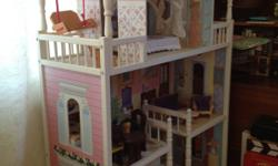"""Dollhouse with furniture. 51"""" high by 34"""" wide by 13.5"""" deep. Big enough to play with Barbies. Call for more info and/or directions. -- (Legos not included). $100"""