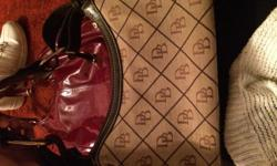 Selling my Dooney & burke purse. It is real. Bought it for 395. Fair condition.