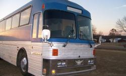 40' eagle conversion to motor home 6 bunks 2 A/C units Refrigerator Micro wave Solid oak cabinets and through out interior On board black and fresh water tanks Toilet room with vanity On board generator 2 couches Dinette booth