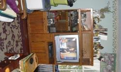 (Overall dimensions...55'' wide, 66'' high, 21''deep).....TV opening (29'' wide, 24''high).....Glass Doors on left for stereo (21'' wide, 31'' high)...two bottom cabinets, pull-out cabinet for vcr tapes....two top openings for knick/knacks, two accordian
