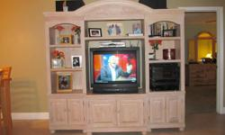 Pecan Entertainment Center.Excellent condition. TV included.Call --, Palm Harbor, FL