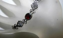 This Estate Sterling Silver Garnet bracelet is presented by Lisa LePaige who has hosted her own shows on the Gem Shopping Network and Today's Shopping Network!  This vintage handmade bracelet features a large and beautiful oval 3ct red garnet