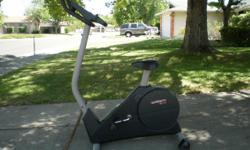 Like new, smooth, adjustable workout, large LCD control panel.