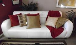 Gorgeous white leather couch. Is used and in GREAT condition. Size: Approx. 82 x 34 x 30.5 $600 Come to our store and check it out yourself. Enchanted Consignments 4501 Wadsworth Blvd. Wheat Ridge, CO 80033  --