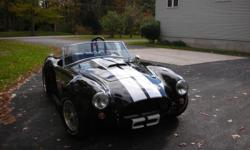 1965 Cobra built in 2005 Black with White strips has a 5.0 V8 cobra engine with appox 350 hp very clean with only 640 miles.