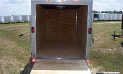 V-NOSE FRONT W/ SOLID WALL CONSTRUCTION, REAR RAMP DOOR & SPRING ASSIST, 32' SIDE DOOR W/ RV FLUSH LOCK W/ KEYS, L.E.D. TAIL LIGHTS, THERMACOOL CEILING, INTERIOR 12 VOLT DOME LIGHT W/ SWITCH, NON POWERED ROOF VENT BRACED FOR A/C, 24? ATP STONEGUARD FRONT,