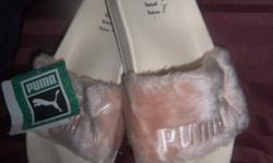 PINK FAUX FUR FENTY PUMA BY RHIANNA, SIZE 6.5, SIZES NORMALLY RANGE A TAD BIT LARGER SO WILL ALSO FIT SIZE 7. EXCELLENT MINT CONDITION, NO TREAD, HAVE NOT EVEN BEEN WORN! TAG IS STILL ATTACHED AND ORIGINAL BOX ENCLOSED. THESE ARE VERY HIGH IN DEMAND AND