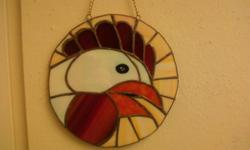This stained glass rooster was hand made in a corner of a little room, in a little house, by m. gibson who lives at the foot of the green mountains of vermont