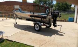 14 foot Lund fishing boat with 8 hp mer. Motor, electric minkota motor,eagle fish finder and big john down rigger.