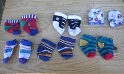 Cute assortment of five pairs of baby boy socks, including one pair that look like mini Converse, and one pair of baby mittens. All in great condition!