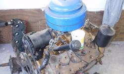 Ford flat head motor, 3 speed trans and some other parts call for details....... 360-301-5376
