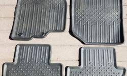 Floor Mats - All Weather Thermoplastic Rubber, Black, 4-Piece Set (Used, very good condition with only minor signs of wear) Retaining system to hold drivers mat in place includes two reinforced rings, one with a locking clip. I originally paid $100