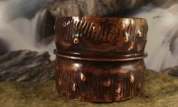 """This is a hand forged fold formed cuff bracelet made from copper sheet. The patina is done with a torch to darken the metal it has been lacquered to protect the patina. Bracelet is 2"""" wide opening is 1&1/2"""" Fits wrist size 6 to 9 easily. This is a unisex"""