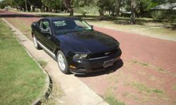 Ford Mustang V6 Auto has 4-0 Engine gets aroun 30mpg. Never been wrecked been a real good car practacly all the miles have been high-way miles.