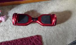 Read hoover board with charger. Works great, a few scratches. Just purchased at Christmas time. Paid 400.00