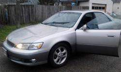 Automatic two tone Sliver and Gray Lexus ES 300 with black leather interior. Only had two owners with 85,000 original miles with a Multi-Cd Disk player. Just had brand new rotors,brakes and pads put on. Please contact: Vera for additional