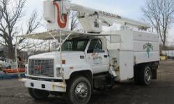 1997 GMC C7500 Dump Truck; VIN: 1GDM7H1JXVJ00277, Caterpillar 3116 Engine, 250HP, 70,473 Odometer Miles, 33,000 Total GVWR, Manual 6-Speed Transmission, Make of Transmission Unknown, AM/FM Stereo, Air Brakes, Rear Swing Door, Box Exterior Width: 7?10?,