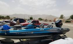 Triton Bass Boat 17'11 foot 150 hp evinrude motor 2 battery chargers dolly to move boat by hand can be seen on fort bliss resale lot. Contact: gerdy@elp.rr.com