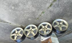 These are four mustang rims with black cobra 17 inch wheels