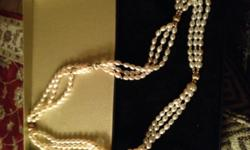 I have a freshwater pearl and 10k gold necklace by designer O.C Tanner. It has never been worn and comes in the original box and velvet bag. The original price was $600 dollars and I am selling it for $100 cash near Alton, IL. If you are interested or
