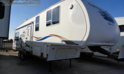 WOW what a catch! With two slides you have tons of room for living large on the road With sleeping for up to six the kids or even the grand kids can get in on all of the great fun and adventure! A full kitchen insures you will never have to eat fast food