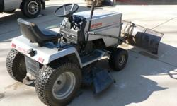 craftsman 18 hp garden tractor with 44 inch mowing deck.. snow plow with wheel wieghts and chains