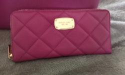This genuine Michael Kors purse and wallet will get the compliments! Only 4 months old, excellent condition. The color us a Raspberry/fushia. Both are all leather and even though they don't look like the same color because of the light, there are a