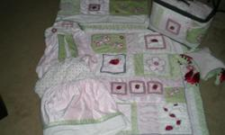 Girls Ladybug/Dragonfly/ Flower Bedding. Used once, Brand New!!!!! Includes Window Valence, Diaper Stacker, Crib Skirt, Fitted Sheet,Bumper, Comforter, And Mobile. Very Pretty.