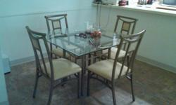 SELLING A SQUARE GLASS DINING TABLE THAT MEASURES 44 1/2 INCHES LONG X 44 1/2 INCHES WIDE X 30 INCHES TALL THE TABLE FRAME IS BROWNISH SPECKLED AND LIGHT FRAMED ALSO A SQUARE GLASS COFFEE TABLE MEASURES 35 1/2 INCHES LONG X 26 INCHES WIDE X 19 INCHES TALL