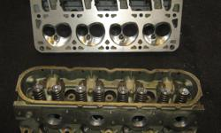 """GM 853 LS1 CYLINDER HEADS 2.00"""" INTAKE VALVES 1.55"""" EXHAUST VALVES 66.67 CC COMBUSTION CHAMBER 200 CC INTAKE RUNNERS 70 CC EXHAUST RUNNERS ALUMINUM HEADS PORTED & POLISHED VALVE JOB RESURFACED CLEANED BOLT ON READY $600.00 BBT INC 40440 US HIGHWAY 19N"""