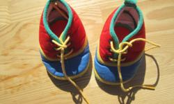 Adorable pair of Gold Bug baby boy crib shoes. These are a size 2. In like new condition. These are red, blue, green and yellow, with yellow laces.