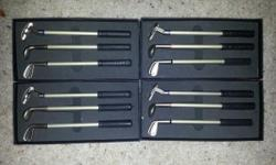 Set of 3 golf club pens in a gift box. Driver, putter and iron write in red, blue and black.