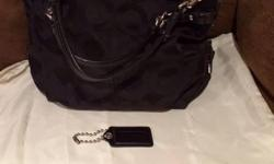 Coach purse is new without tags. I bought it for $250 plus tax. But, all I'm asking is $150 and it Includes dust bag.